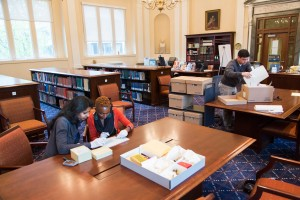 Researchers working in the HLS Library Historical & Special Collections Root Room