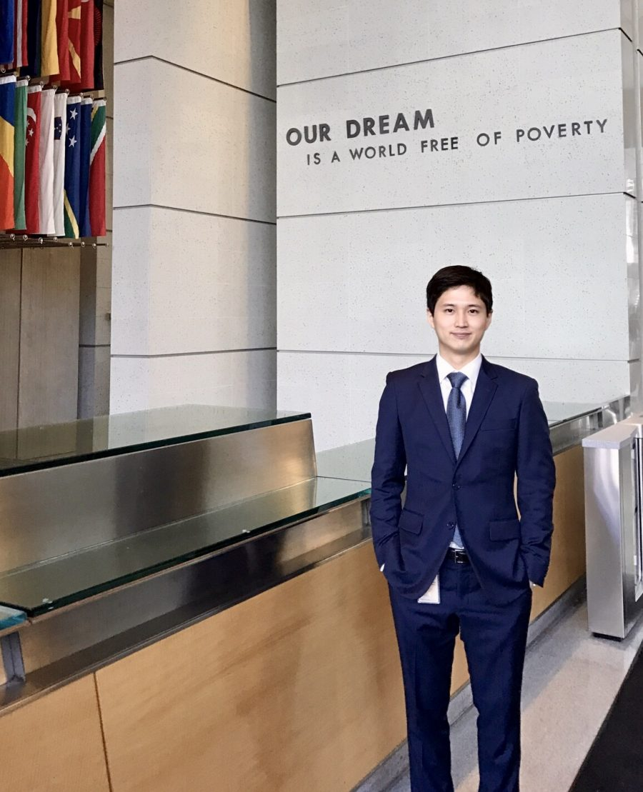 Photo of Jisan Kim infront of the World Bank in Washington DC