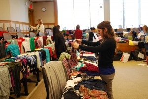 Community members browse donated clothing at the annual Fashion Swapaganza.