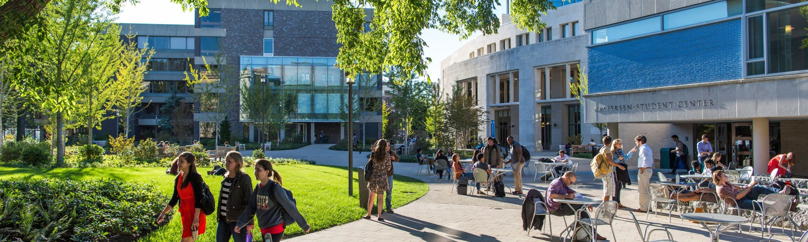 Students walking on campus on a sunny day