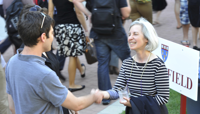 Dean Minow shaking student hand