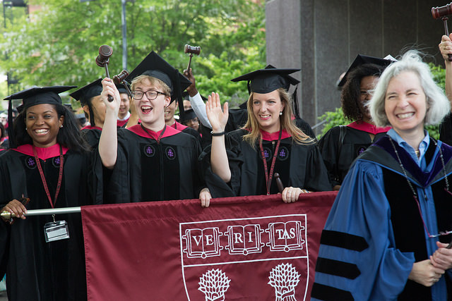 Class Marshals holding HLS Banner on Commencement procession