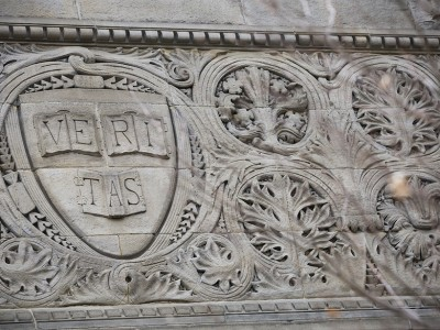 Veritas shield on exterior of Austin Hall