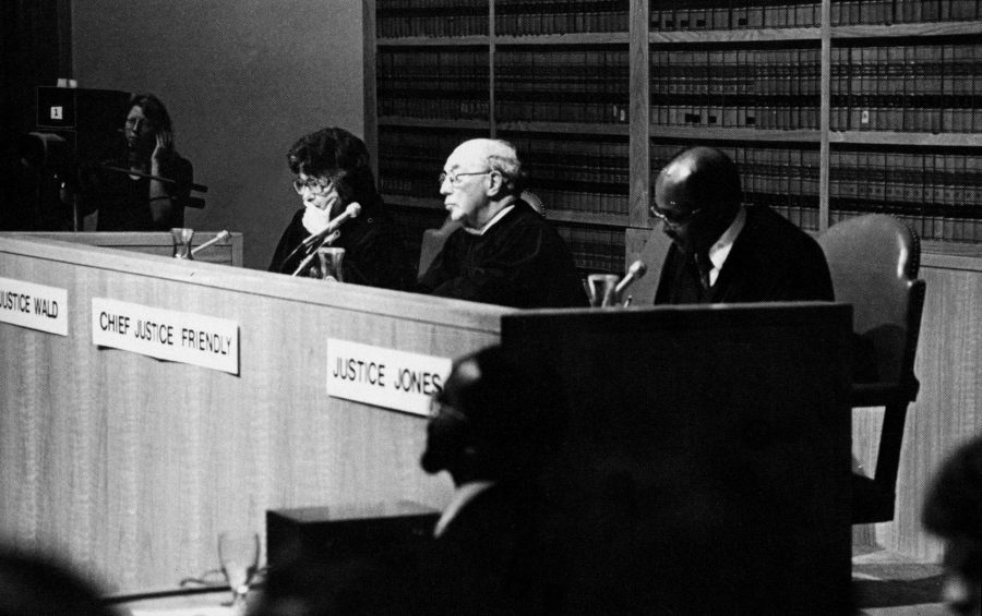 Judges behind bench listen to arguments from Ames Moot Court competitors