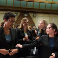 Ames Moot Court participants give each other encouraging smiles