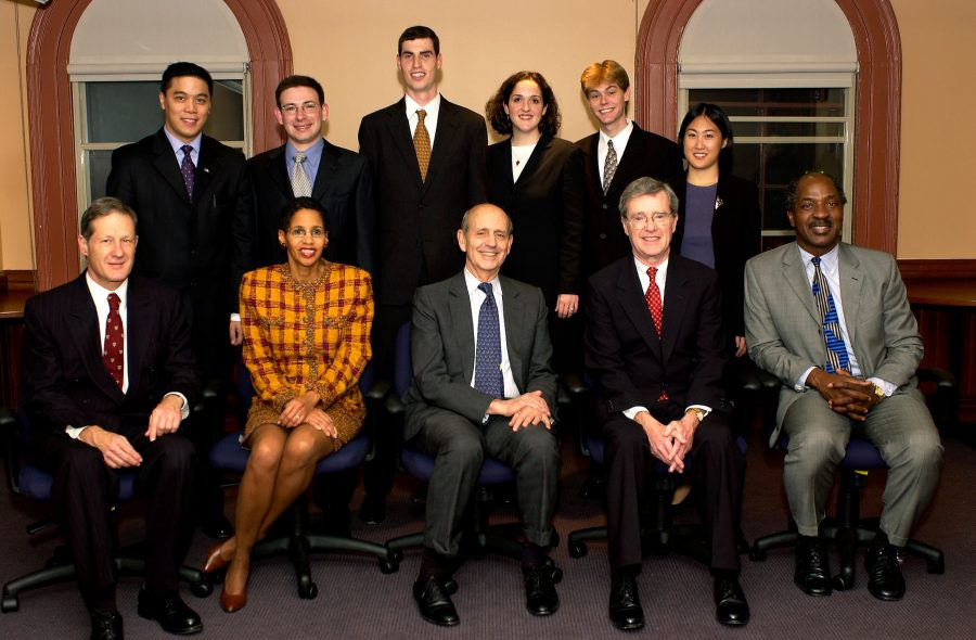 Ames Moot Court participants stand behind seated judges and HLS faculty members
