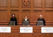 Hon. John Paul Stevens, Associate Justice (Ret.), U.S. Supreme Court, smiling at the bench of the Ames Moot Court