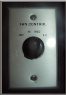 Fan control switch with center turning knob.