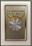 Thermostat with radial dial control.