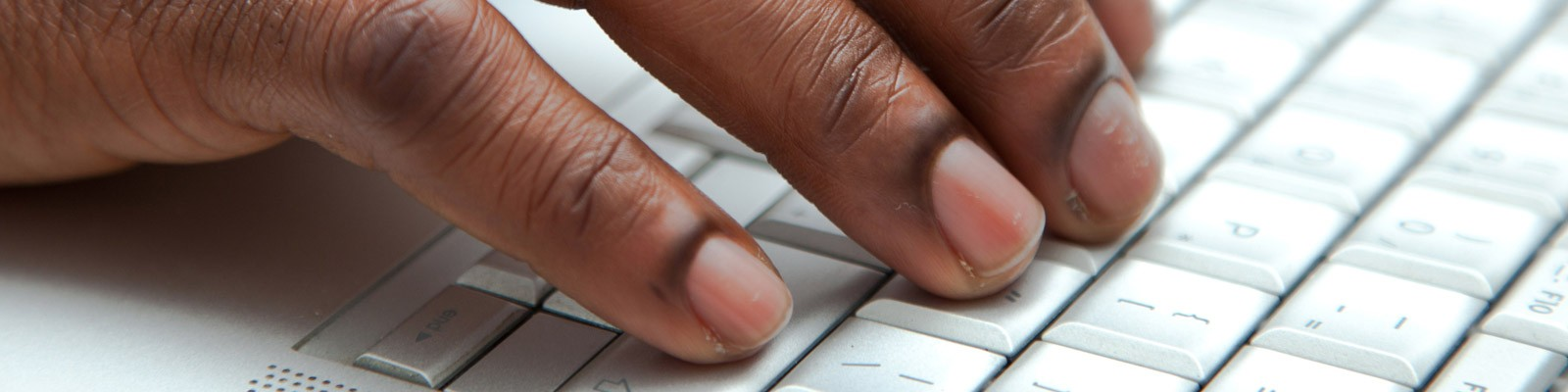 Close up of fingers typing on computer keyboard
