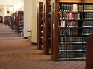 The stacks viewed from the center aisle of the 4th floor reading room in the Harvard Law School Library