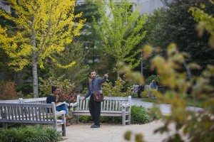 Students relaxing on bench outside