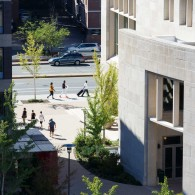 High-level view of WCC building and people walking by on street