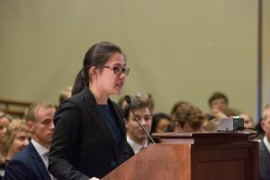An oralist speaks at the podium at the Ames Moot Court Competition