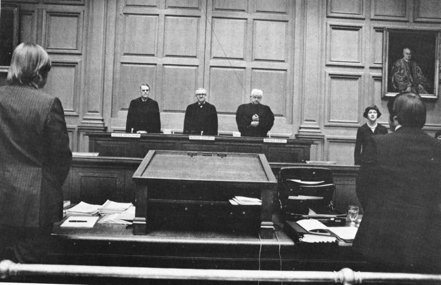 Three judges stand at the bench of the Ames Moot Court Competition