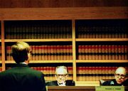 Judge Blackmun listens to oralist at Ames Moot Court Competition