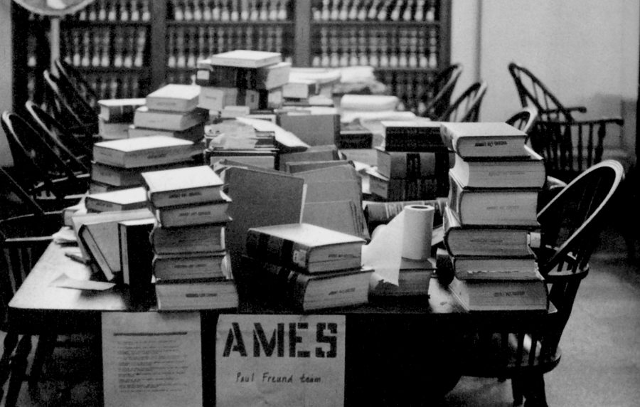 Table piled high with Ames Moot Court case material