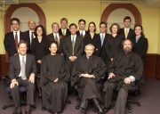 Ames Moot Court participants stand behind seated judges