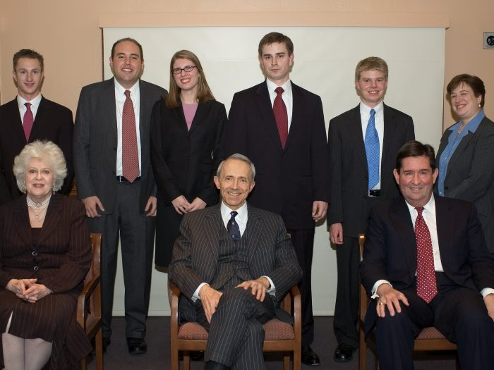 Ames Moot Court participants stand behind three seated judges