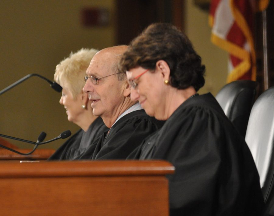 Three judges sit at the bench at the Ames Moot Court Competition