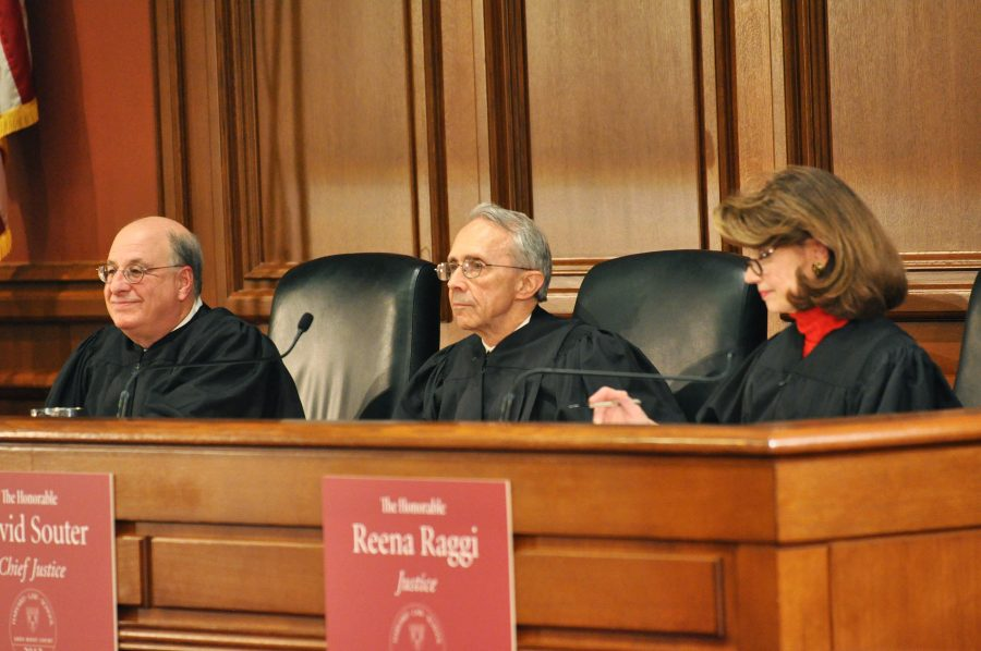 Three judges sit at the bench of the Ames competition