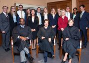 Ames participants stand behind three seated judges
