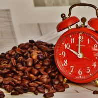 coffee beans next to an alarm clock