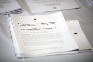 A stack of collated draft papers with the Harvard Seal on top