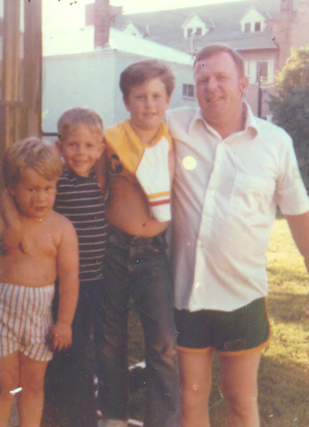 Family photograph of Cam MacDougall '01 with his two brothers and father.