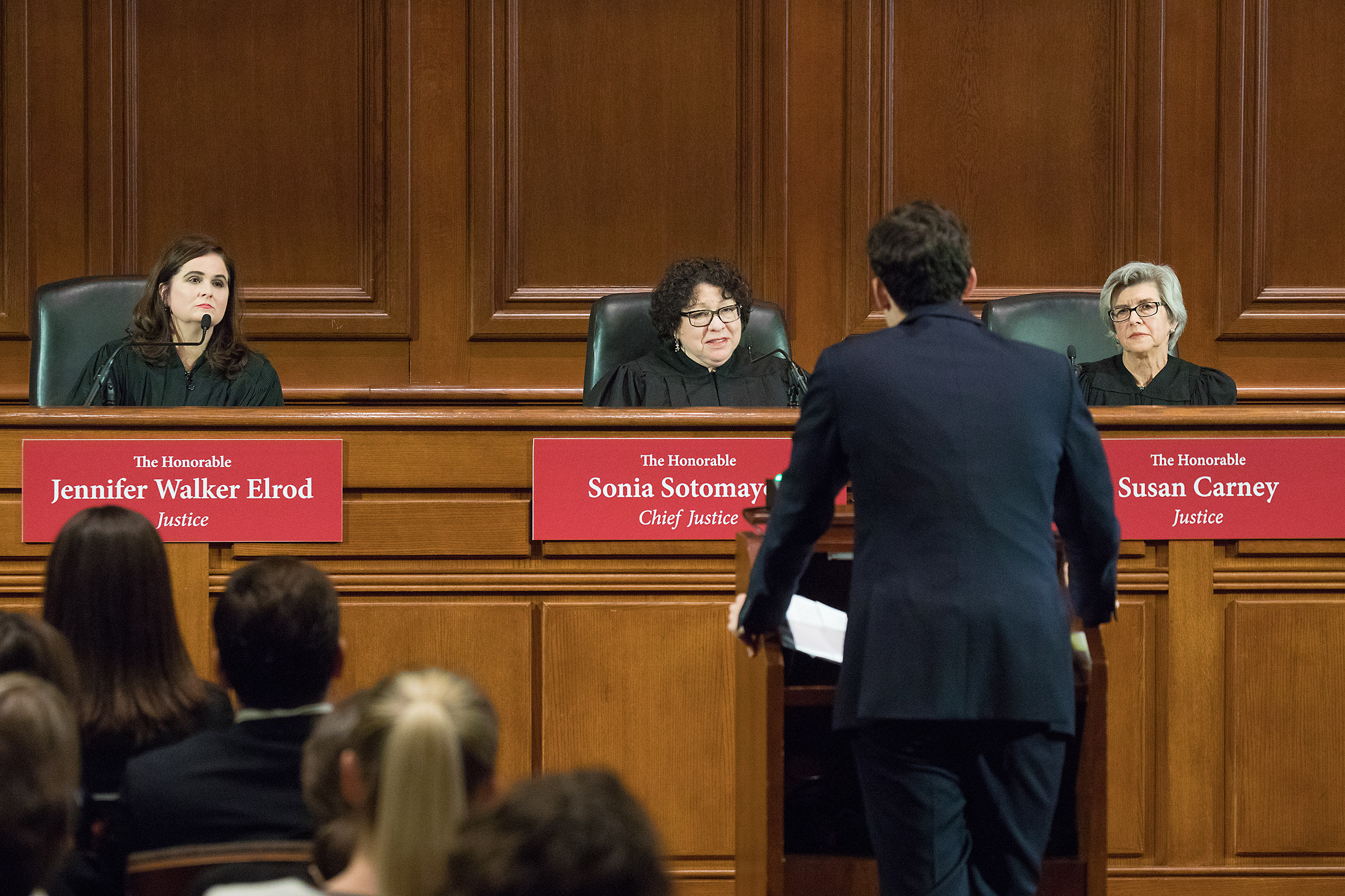 An Ames Moot Court participant stands at a podium in front of three judges sitting on the bench