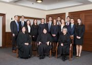 All Ames Moot Court participants and three judges stand together for a photo