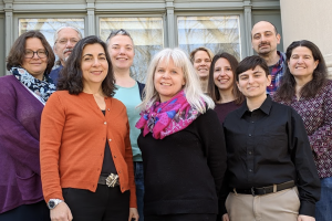 A group of Library staff stand in front of Langdell Hall (left to right: Mindy Kent, Stephen Wiles, Deanna Barmakian, Anna Martin, Jennifer Allison, Lisa Lilliott, Catherine Biondo, AJ Blechner, George Taoultsides, Michelle Pearse)