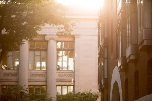 Soft sunlight glows on buildings across campus