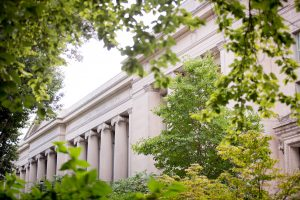 Greenery frames the columns of Langdell Hall