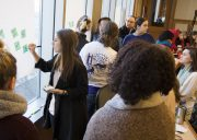 Students write on post-it notes during a workshop