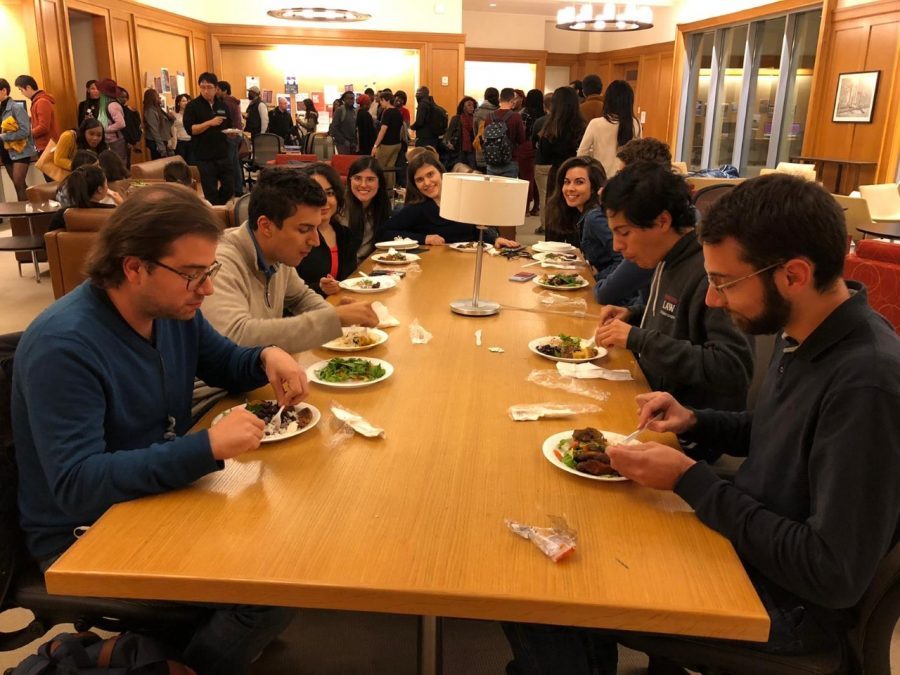 CISGA members gathered around a table for an event.