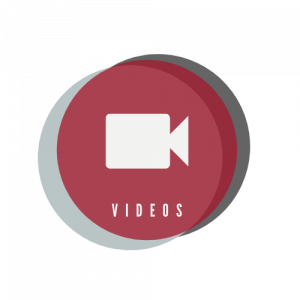 """Circular, multicolored icon containing an illustration of a video camera above the word """"Videos"""""""